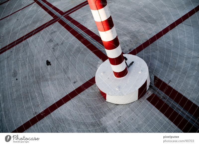 ringlet tower in the sea of lines Asphalt Parking lot Red Circle Places Variable Division Concrete Parking garage Symbols and metaphors Warning colour Line