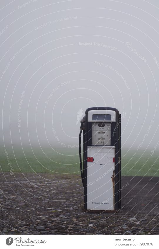 350 and refuelling times Environment Autumn Bad weather Fog Grass Meadow Collector's item Petrol station Petrol pump Stone Concrete Steel Rust Discover Old