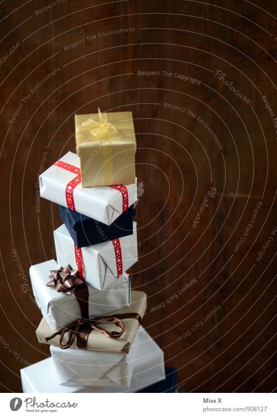 Bulky Feasts & Celebrations Birthday Packaging Package Bow Tall Emotions Moody Anticipation Lack of inhibition Christmas gift Gift Stack Giving of gifts Donate