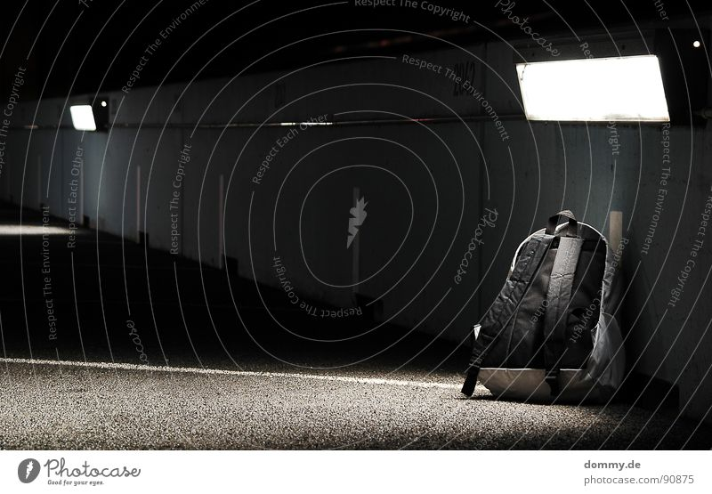 it's ticking... Backpack Night Loneliness Bomb Terror Terrorism Explosives Cloth Light Forget Stripe Parking lot Time bomb Dangerous Fear Panic Train station