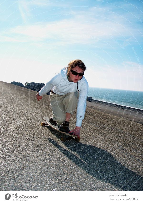 Woman Youth (Young adults) Sky Ocean Blue Street Sports Playing Style Movement Speed Action Skateboarding Sportsperson