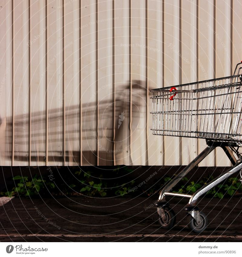 shadow Grating Aluminium Easy Tin Wall (building) White Yellow Dark Night Long exposure Würzburg Grass Lettering Bulge Destruction shopping cart Old Coil Wheel