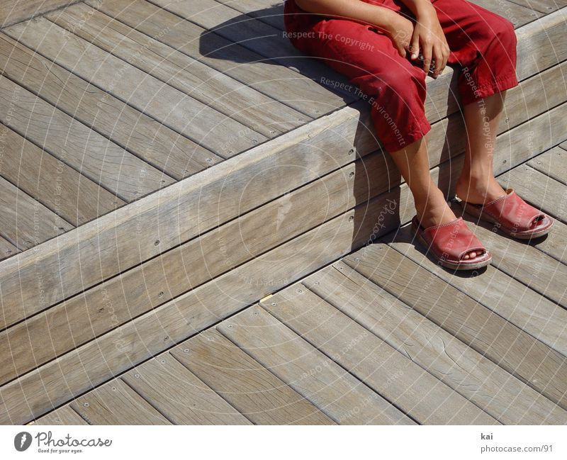 rest Girl Break Pants Red Hand Photographic technology Sit Feet Sandal Section of image Exterior shot Wait