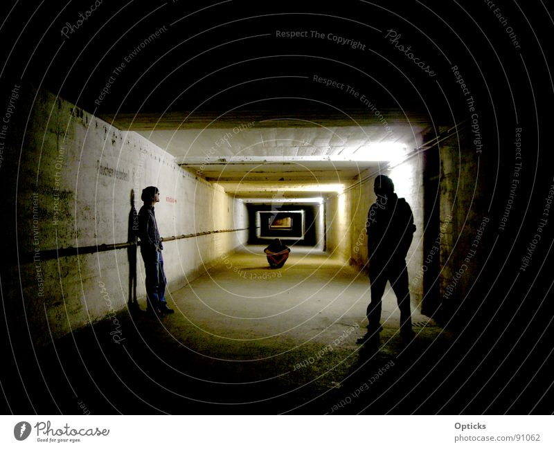 tunnel vision Tunnel Dark Light Think Cellar Emergency exit Man Shadow Human being Far-off places Corridor