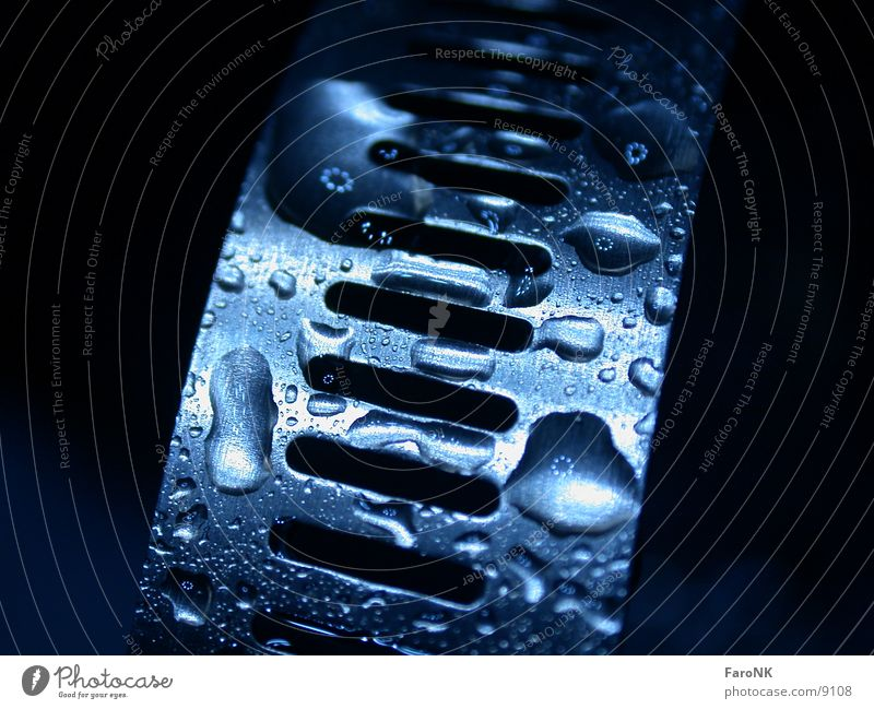 Blue Metal Glittering Wet Drops of water Damp Partially visible Section of image Glimmer High-grade steel Clamping piece Dark background