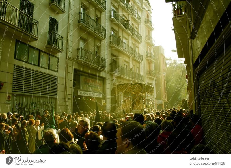 Human being Group Warmth Facade Physics Mask Crowd of people Spain Barcelona Carriage Shaft of light Catalonia Holy Week