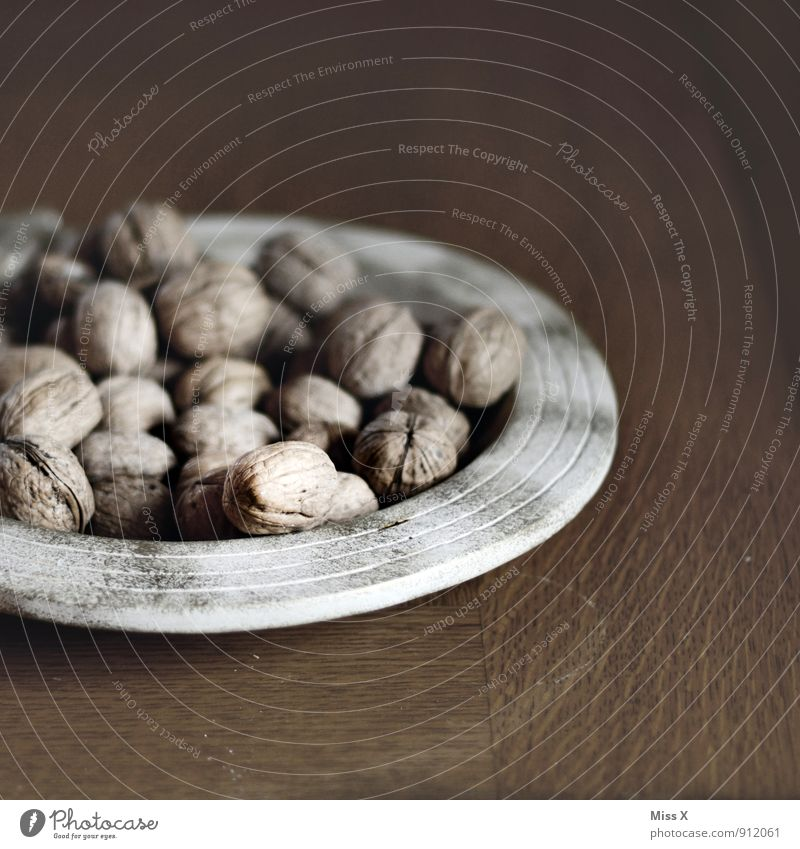 walnuts Food Nutrition Organic produce Vegetarian diet Plate Decoration Brown Walnut Nutshell Hard Edge of a plate Wooden table Christmas decoration