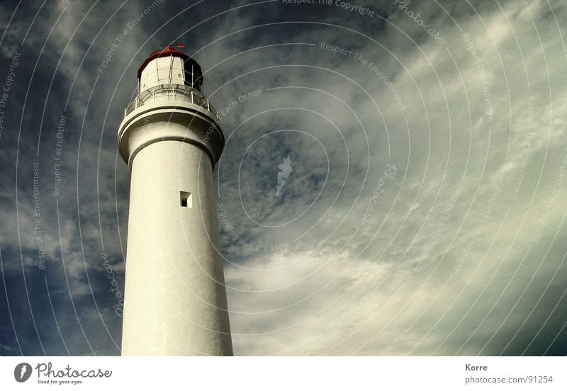Sky Ocean Clouds Far-off places Freedom Coast Wind Tall Round Level Vantage point Tower Monument Navigation Landmark Lighthouse