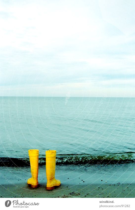 long gone Ocean Yellow Rubber boots Lake Grief Escape Dream Desire Waves Surf Boots Clouds Cyan Leave behind Beach Coast Blue Water Sky Sadness Lanes & trails