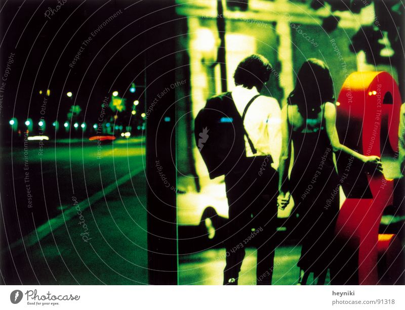 Green Street Couple Wait In pairs Advertising Station Night Traffic infrastructure Neon light Poster Night shot
