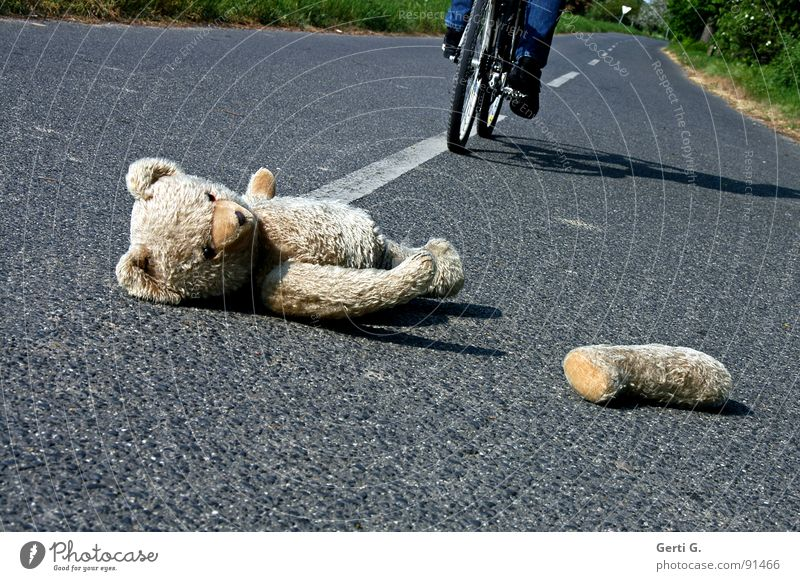 crash test teddy Accident First Aid Traffic accident Middle of the road Bicycle Bicycle tyre Tracks Teddy bear Toys Cuddly toy Doomed Median strip Amazed