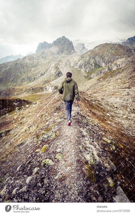 Walk to Mordor Mountain Going Switzerland Alps Footpath Scouts Hiking Dramatic Storm clouds Escape Loneliness Individual Peak Sadness Walking Sparse Rock Man