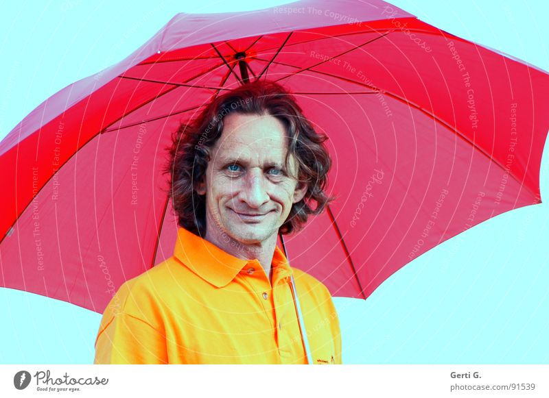 The boy with the umbrella is here. Man Masculine Freak Face Laugh lines Curly Happiness Friendliness Umbrella Red Shielded Congenial Dry Drought Rainmaker