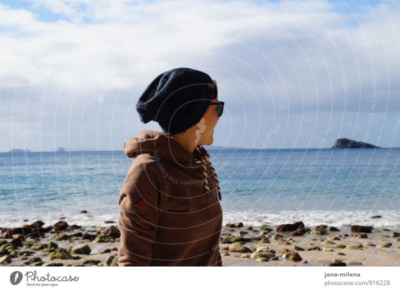 Behind the horizon Ocean Longing Beach Looking Horizon Cap Sunglasses Hooded sweater Hooded (clothing) Vacation & Travel Walk on the beach Relaxation Island
