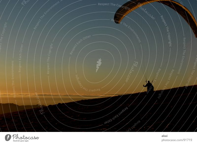 Evening at Schauinsland Paragliding Paraglider Play of colours Sky blue Romance Sunlight Sunbeam Sunset Departure Homey Bronze Emotions Puppy love Orange