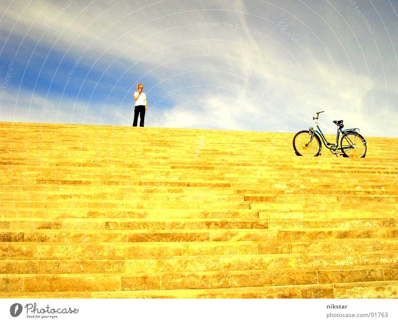 Human being Sky Man Youth (Young adults) Blue Sun Clouds Yellow Movement Gray Blonde Bicycle Gold Leisure and hobbies Stairs Beautiful weather