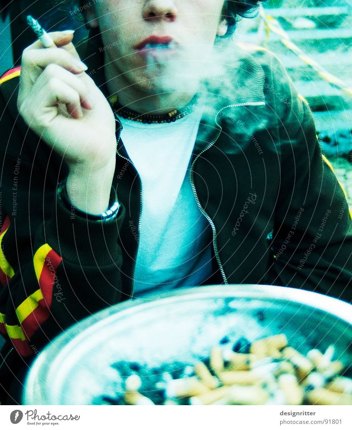 Youth (Young adults) Search Individual Smoking Smoke Cigarette Partially visible Ashtray Nicotine Detail of face 1 Person Inhale Cigarette Butt