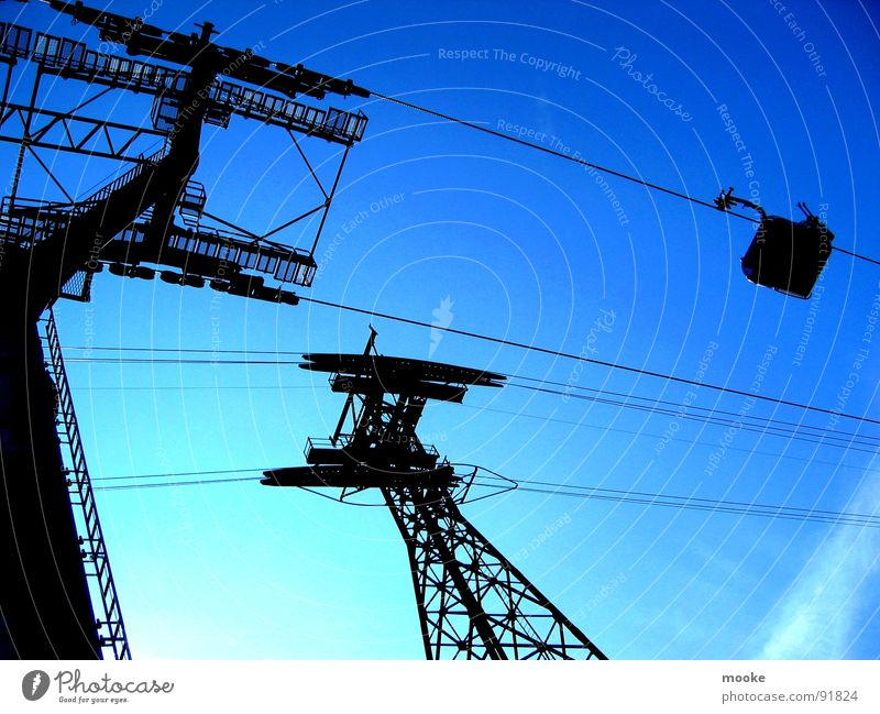 Sky Blue Upward Vertical Blue sky Sky blue Gondola Cable car Steel carrier Steel construction Skyward Steel tower Bright background