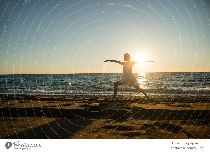 Woman doing yoga on the beach in the evening sunset Athletic Fitness Life Harmonious Well-being Relaxation Meditation Vacation & Travel Summer Summer vacation