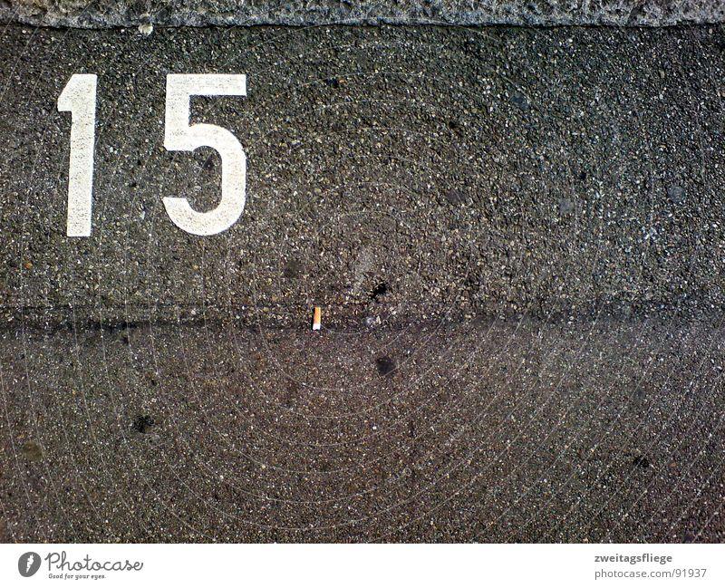 Line Floor covering Digits and numbers Asphalt Cigarette Sidewalk Traffic infrastructure Parking lot Tar Chewing gum Symbols and metaphors 15