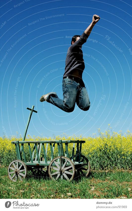 VIVA! Man Fellow Jump Carriage Trolley Derelict Meadow Degrees Celsius Canola Yellow Summer Brilliant Sweater Pants Footwear Wood Pure Leisure and hobbies