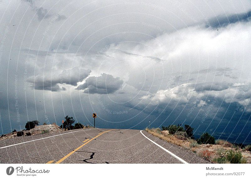 Road to nowhere Gale Clouds California In transit Ambiguous Clear Traffic infrastructure Sky USA Thunder and lightning Rain Street road layout away into nowhere