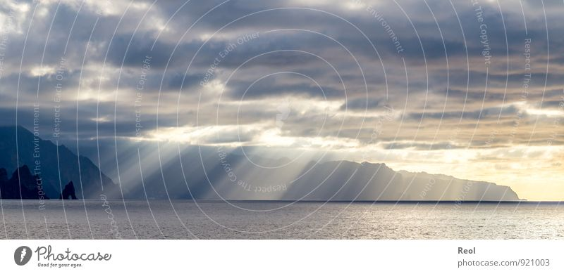 Sky Nature Vacation & Travel Blue Water Summer Sun Ocean Landscape Clouds Beach Environment Coast Rock Dream Orange