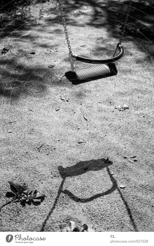 playground Leisure and hobbies Playing To swing Playground Swing Sand Calm Loneliness Infancy Black & white photo Exterior shot Deserted Day Light Shadow
