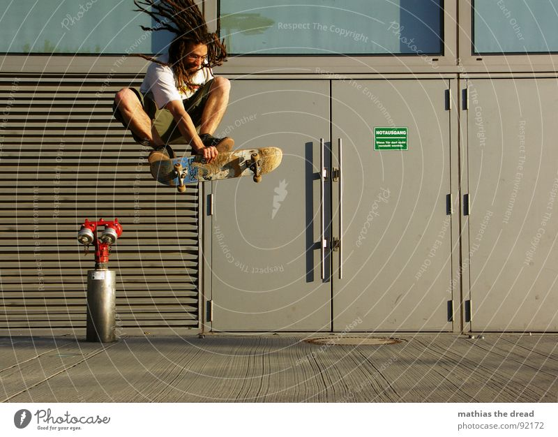 City Joy Far-off places Sports Jump Playing Movement Hair and hairstyles Healthy Flying Concrete Tall Action Touch Skateboarding Fire prevention