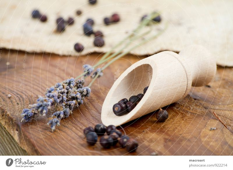 juniper berries and lavender Kiddy shovel Juniper Berries Wooden spoon Lavender Dried spice spoon Linen Wooden floor Spoon cooking ingredients Herbs and spices