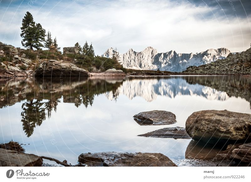 Soul balm is sitting by the mirror lake. Vacation & Travel Tourism Trip Far-off places Mountain Hiking Mountain lake Mirror Lake Landscape Sky Clouds Summer