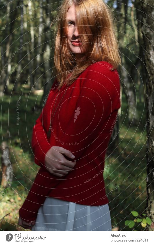 Young woman in red sweater and white skirt is standing in the forest and smiling Trip Adventure Youth (Young adults) 18 - 30 years Adults Nature