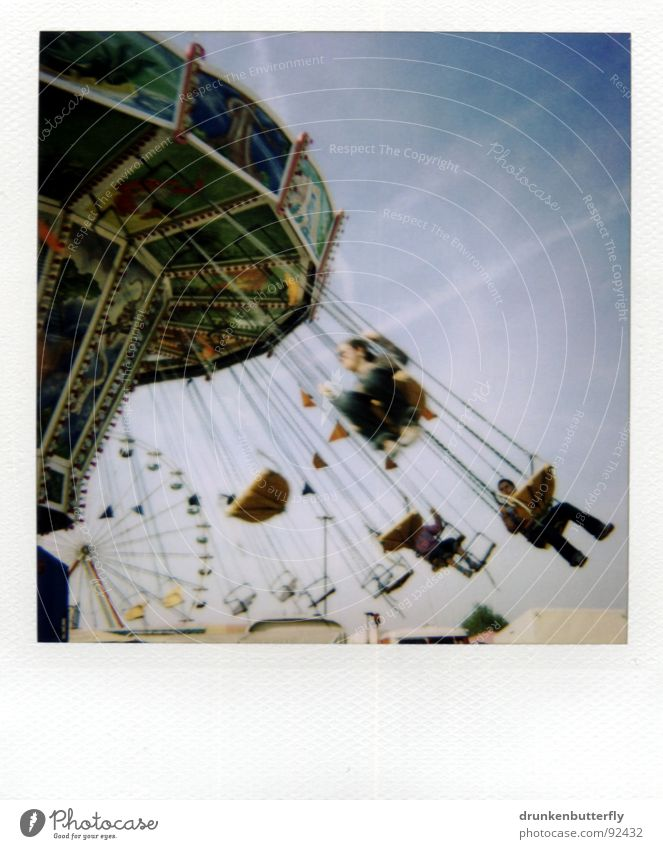 fly through the air Rotate Circle Fairs & Carnivals Giddy Multicoloured Gray Polaroid Sky Human being Blue Chairoplane Detail Section of image Partially visible