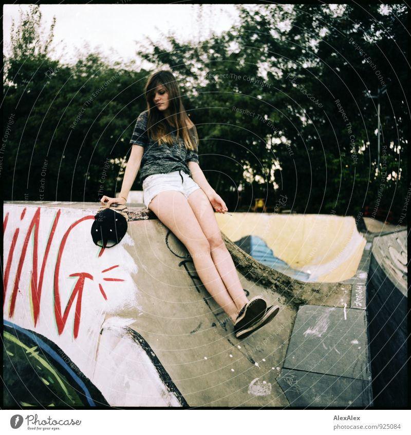 ing Style Inline skating Skate park Young woman Youth (Young adults) Legs 18 - 30 years Adults Tree Wall (barrier) Wall (building) Hot pants Cap Chucks Brunette