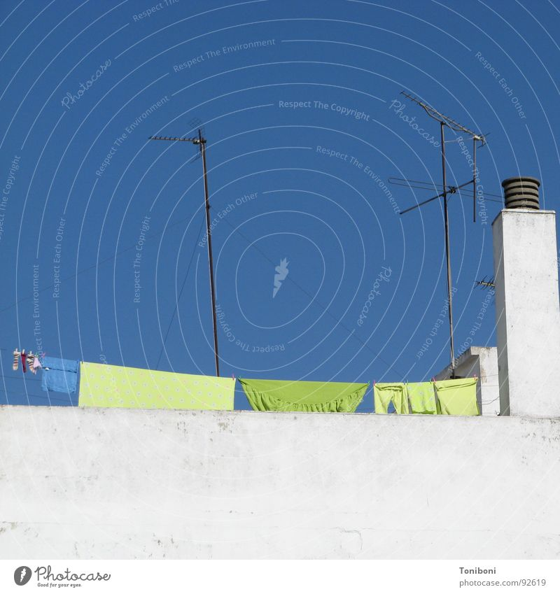 Spanish Laundry Spain Seville Andalucia Green Antenna Roof Wall (barrier) Clothing Blue Chimney White Roof terrace Cloudless sky Clothesline Dry Washing