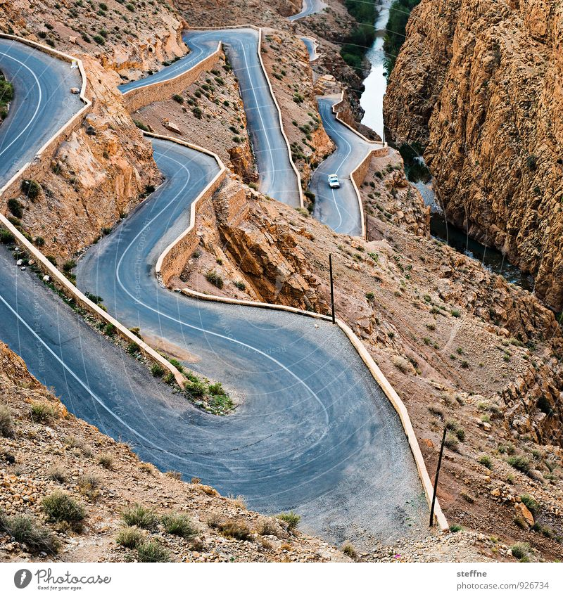 away downwards Nature Landscape Mountain Canyon Traffic infrastructure Motoring Street Blue Brown Winding road Dangerous Morocco dades gorges du dades Atlas