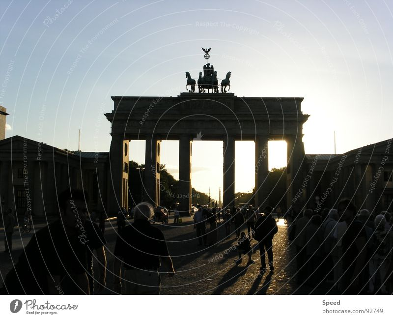 Shadow play in Berlin Brandenburg Gate Visual spectacle Dark Crowd of people Tree Clouds Dream Europe Beautiful Squad Exterior shot Modern Architecture Sun