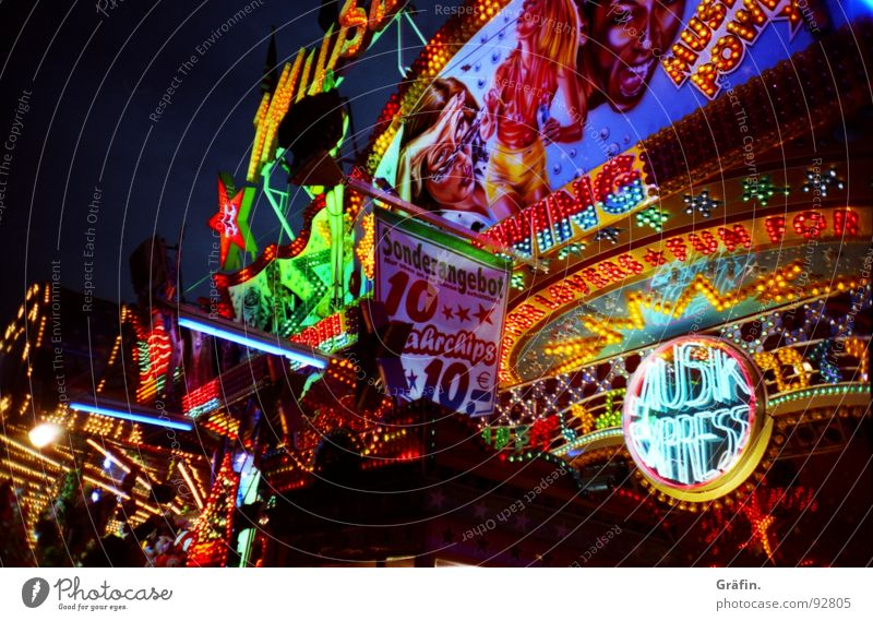 Colourful diversity Shooting match Fairs & Carnivals Summer July Hannover Light Night Multicoloured Electric bulb Glittering Lottery booth Theme-park rides