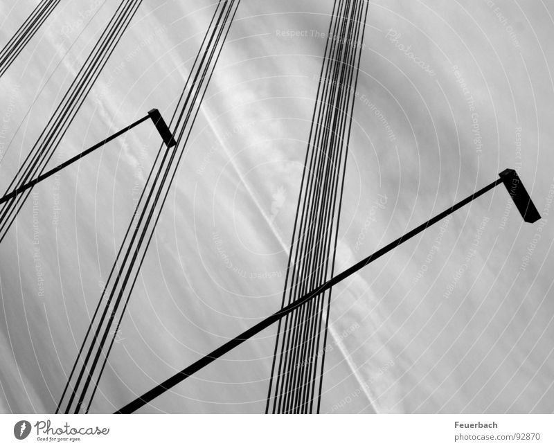 Lines against a turbulent background Black & white photo Exterior shot Pattern Structures and shapes Deserted Lamp Cable Sky Clouds Weather Rain Bridge