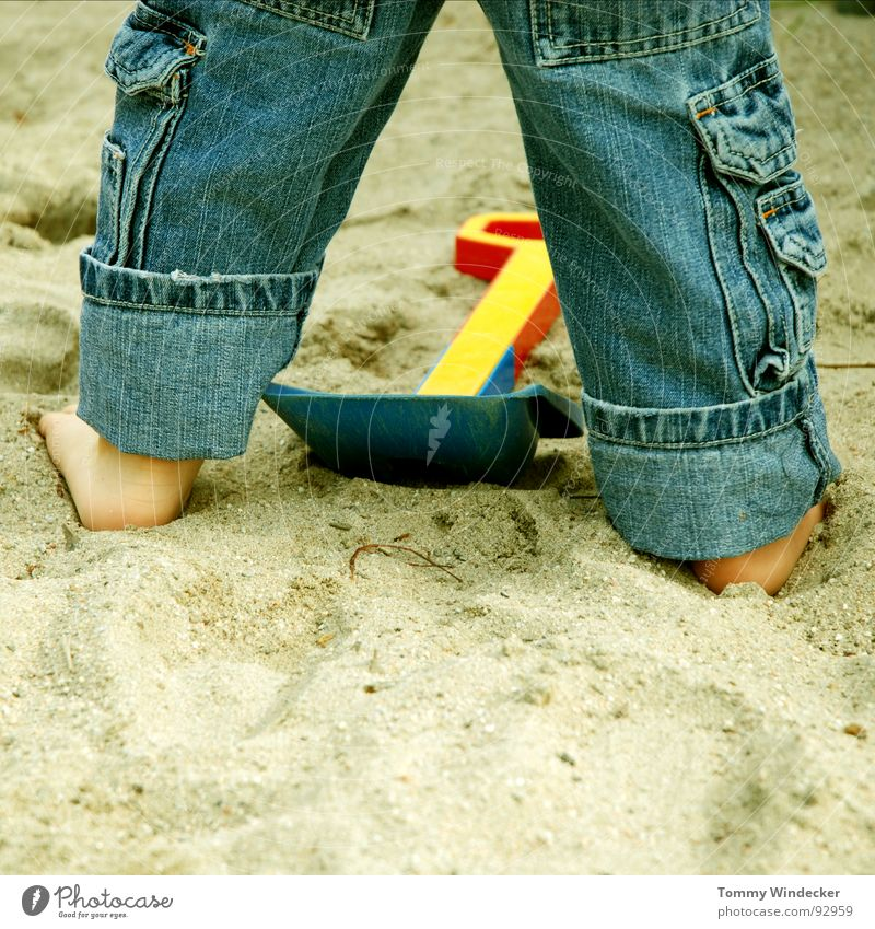 Child Blue Vacation & Travel Red Ocean Summer Beach Joy Yellow Playing Boy (child) Sand Legs Feet Infancy Leisure and hobbies