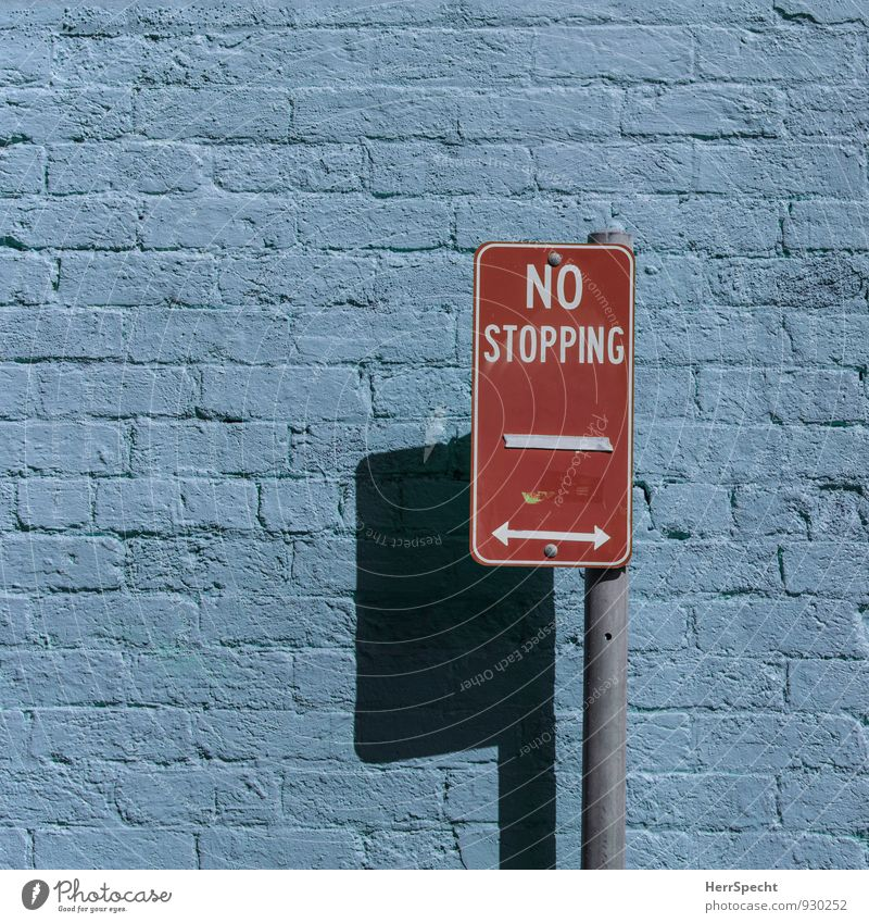 drive-on zone Sydney Australia New South Wales Building Wall (barrier) Wall (building) Characters Road sign Blue Red No standing Arrow Zone Brick wall