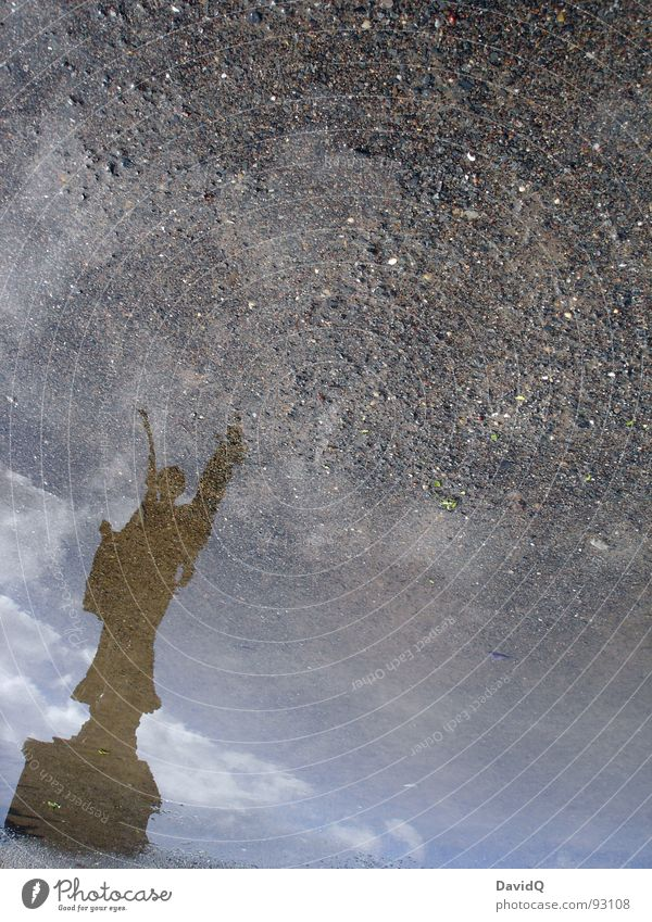 angels Statue Pedestal Puddle Reflection Aspire Go up Under Historic Landmark Monument Angel Wing Stone Sky Earth Water puddle picture Above Surrealism