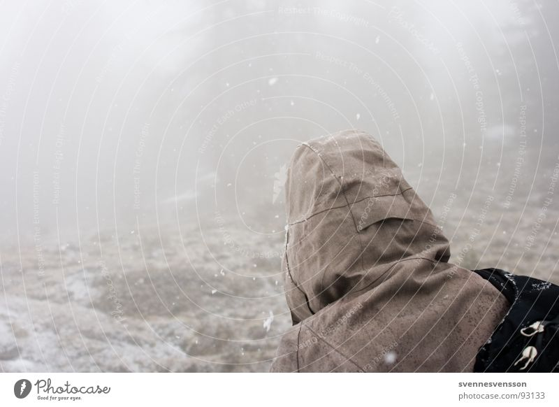 Human being Sky Winter Calm Cold Snow Playing Mountain Ice Rock Back Fog Adventure Hill Hooded (clothing) Backwards