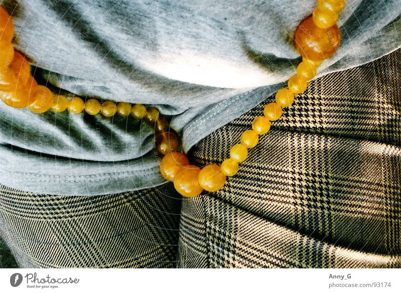 I have to sit down, the chain is so heavy. Gray Amber Light Pants Woman Beautiful Chain Wrinkles Shadow T-shirt Checkered