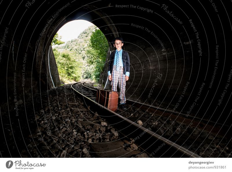 Child walking on railway road in tunnel Human being Woman Vacation & Travel Old Beautiful Dark Adults Street Boy (child) Lanes & trails Line Transport Speed