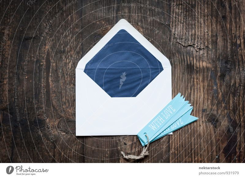 White envelope on wooden chest with blue pendants Design Valentine's Day Mother's Day Birthday Business Musical notes Stationery Paper Piece of paper Love