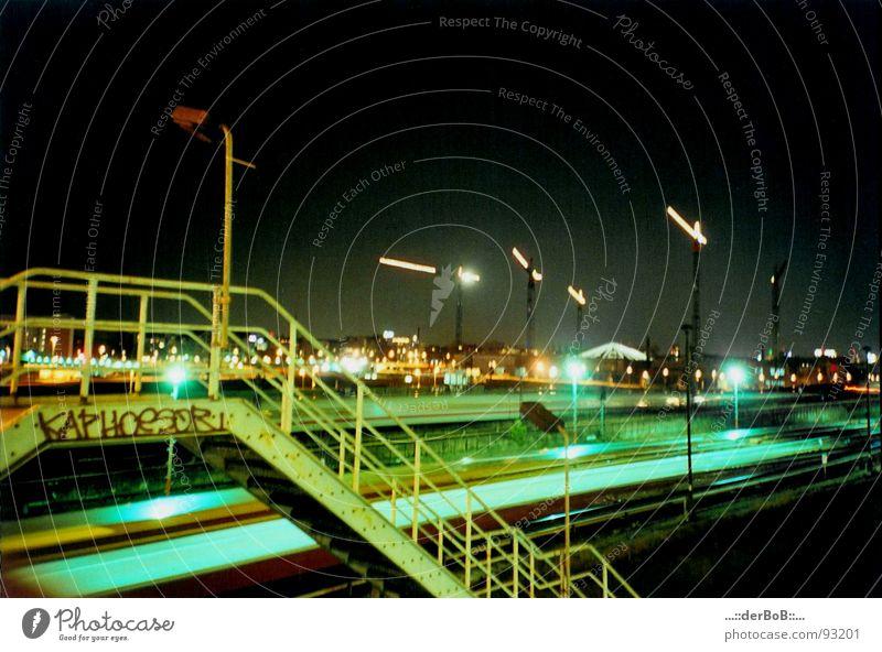 KAPHOeSOR Germany Warschauer Bridge Railroad Crane Railroad tracks Night Lantern Green Yellow Analog Lomography Long exposure Capital city Berlin Handrail