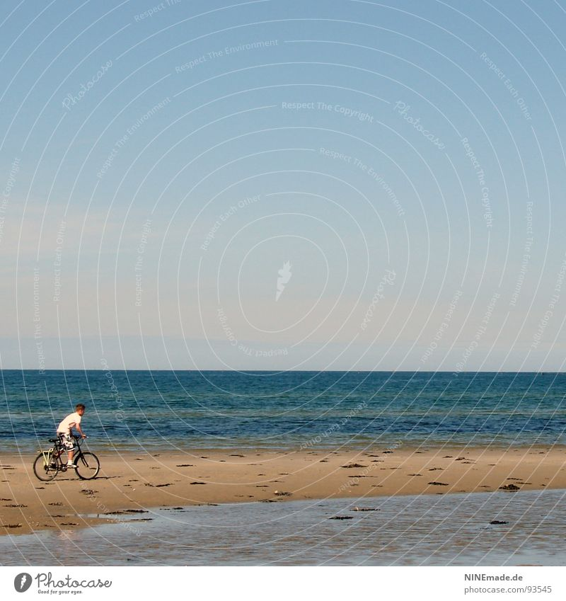 jet Ocean Sky blue Beach Sandbank Low tide Bicycle Cycle race Brave White Beige Grainy Pedal Far-off places Small Water Leisure and hobbies Blue Boy (child)