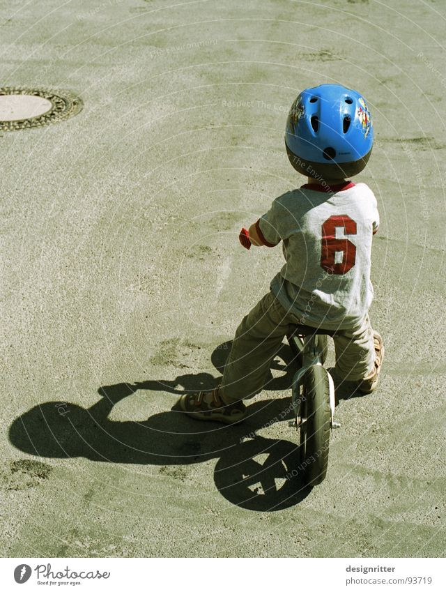 Child Boy (child) Bicycle Cool (slang) Driving Brave Helmet Resolve