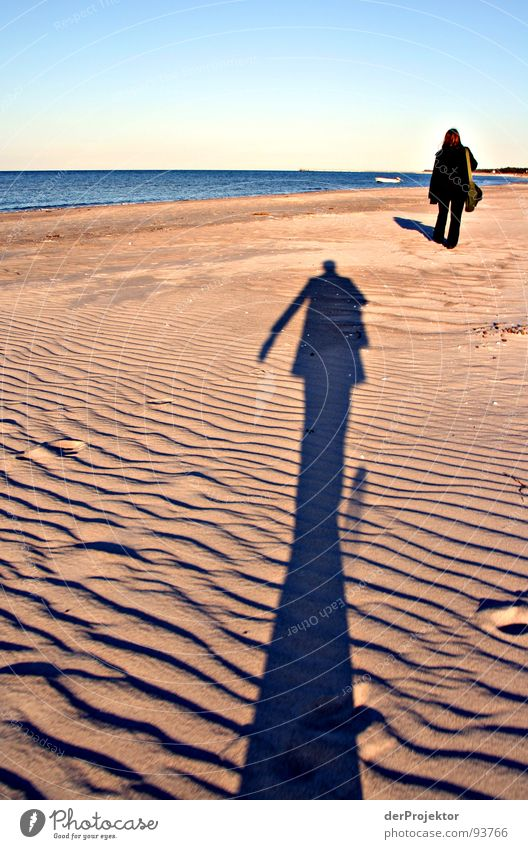 What was left of the day... Ocean Beach Man Woman Stalking Black Coat Pants Sculpture Emotions Shadow Chase Beach dune Blue Sky Contrast Baltic Sea Line